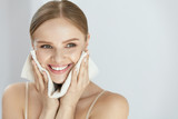 Cleaning Face Skin. Beautiful Happy Girl Washing Face - 167579465