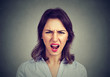 Annoyed angry woman screaming. Negative human emotions - 167584208