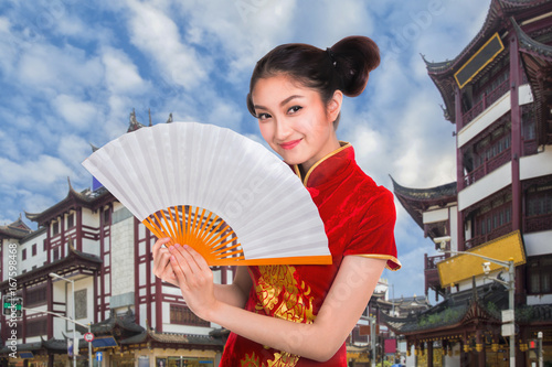 Chiness lady in cheongsam dress with Shanghai vintage building and street