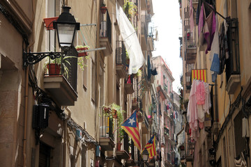 Barcelona, May 2015;  Balconies and windows with flags and clothes hanging out