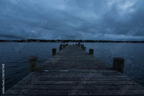 Foto op Aluminium Pier Stormy night on the boardwalk