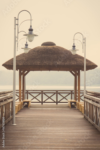 Foto op Aluminium Pier Vintage photo, Wooden pier at lake on cloudy day