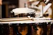 Drumsticks lying on timpani closeup in dark colors