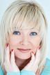 Blond woman with sapphirine eyes
