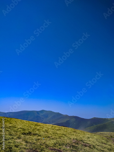 Foto op Aluminium Donkerblauw Background landscape with Ukrainian Carpathian Mountains in the Pylypets