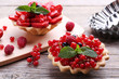 Quadro Dessert tartlets with berries on grey wooden table