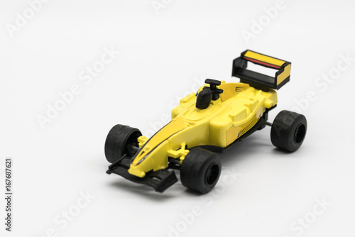 Fotobehang Formule 1 Yellow toy as formula car isolated on white