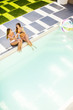 Three young women by the pool