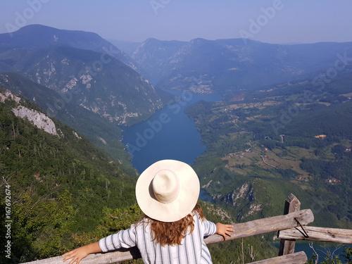 Fridge magnet girl on mountain viewpoint