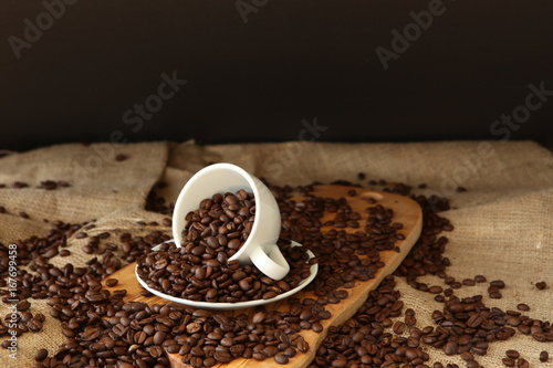 Porcelain cup and coffee beans