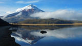 View of the Limpiopungo lagoon with the Cotopaxi volcano reflected in the water on a cloudy morning - Ecuador - 167703260