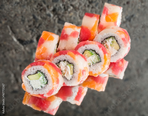Roll made with tuna, salmon and scallop