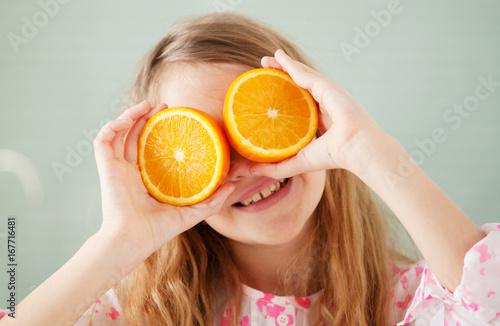 Cheerful girl with orange