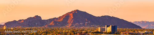 downtown Phoenix, Arizona skyline with famous camelback mountain at sunset - 167723280