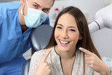 Satisfied dentist patient showing her perfect smile - 167723804