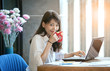 happiness smiling face of young asian woman drinking hot coffee as freelance working