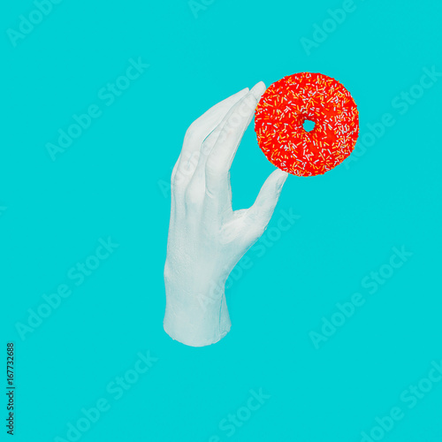 Plastic hand and donut. Minimal art Collage