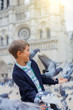 Boy with birds near Notre Dame de Paris cathedral in Paris, France