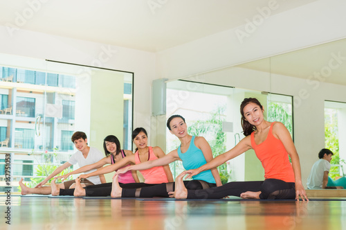 Sticker Yoga class in studio room,Group of people doing seated side stretch right poses with calm relax emotion,streaching pose,Wellness and Healthy Lifestyle.
