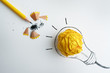 the yellow pencil with yellow crumpled paper ball and hand drawn a light bulb , creative innovation idea symbol concept