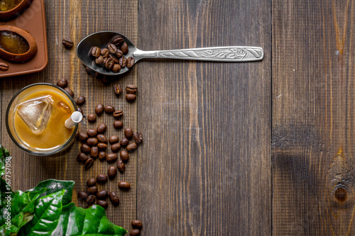 Wall mural coffee with ice in glass on wooden background top view