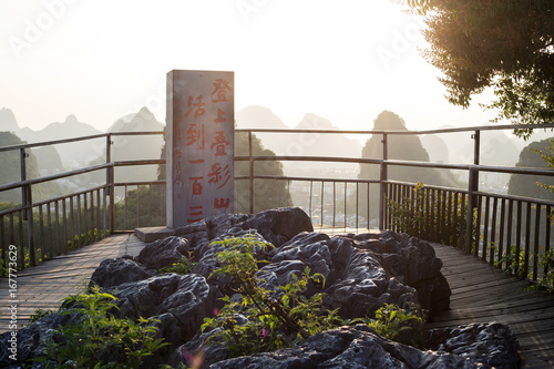 guilin,china - MAY,27,2017:A stele on the diecai mountain peak,the text means come to this mountain,you can live to hundred thirty years old.