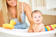 Baby bathing in the bathroom with his mother