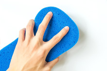 Closeup Of Hand Holding Blue Sponge For Car Wash   Sticker