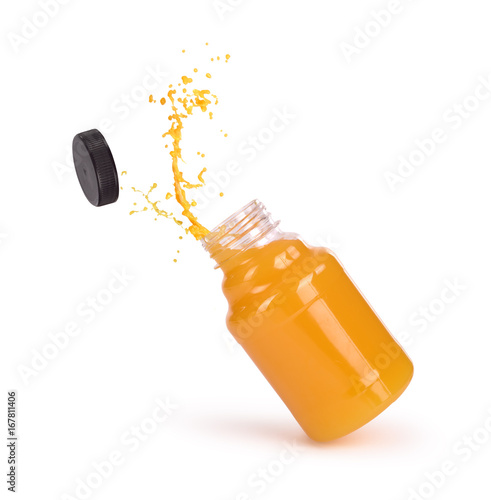 Deurstickers Sap orange juice splash in bottle isolated