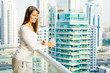 Woman on a highrise balcony