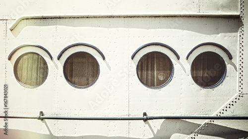 Staande foto Schip Retro stylized close up picture of an old ship portholes.