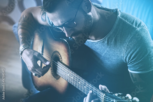 handsome man playing acoustic guitar Poster