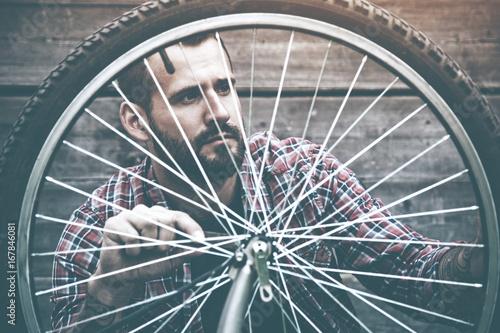 man repairing bike