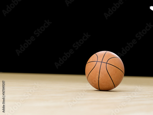 Plexiglas Basketball court wooden floor with ball isolated on black with copy-space