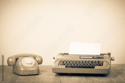 In de dag Retro Retro old typewriter and telephone on table. Vintage style sepia photo