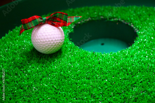 golf ball at hole for Christmas holiday - 167856277