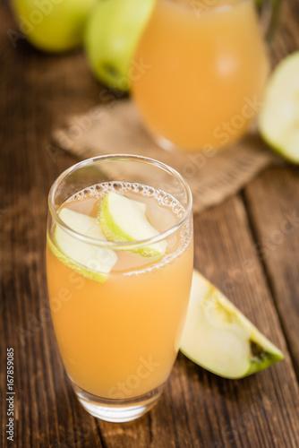 Apple Juice on vintage wooden background