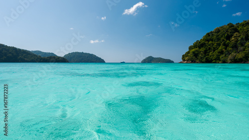 Fotobehang Groene koraal Blue and bright sea water surface at the open sea, Beautiful blue sea at Surin island, Thailand