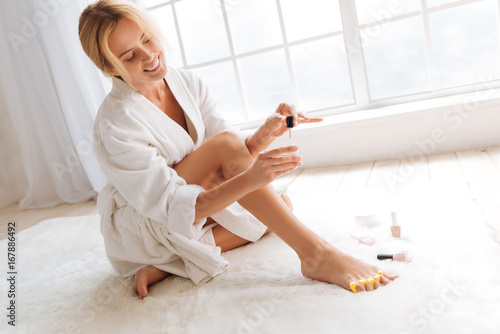 Positive delighted blonde being glad of perfect color