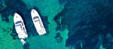 Aerial view of two yachts and clear turquoise sea - 167890425