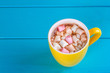 Quadro Yellow cup of hot cocoa with marshmallows