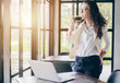 Portrait of young mixed race businesswoman (Her dad is British, Her mom is Thailand) take a coffee break during office time.