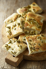 Homemade bread with olives, herbs and olive oil