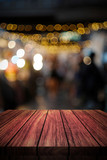 wooden table in front of abstract blurred background of lights - 167910207