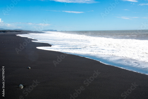 Black sand beach, Reynisfjara shore near the village Vik, atlantic ocean, Iceland