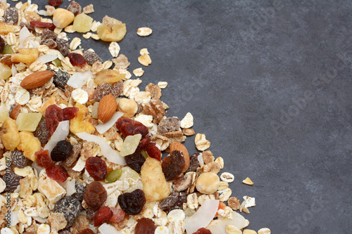 Muesli in diagonal line on dark grey slate background - 167917687