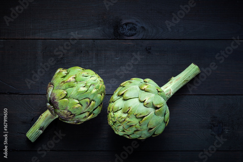 Fresh green artichokes on wooden table