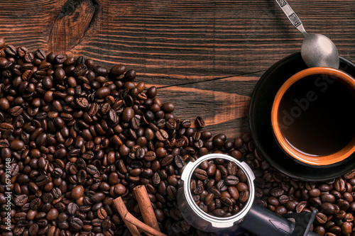 Coffee cup and beans frame on wooden table