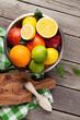 Quadro Fresh citrus fruits in colander