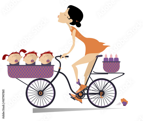 Pretty young woman, a bike and babies isolated. Smiling young woman rides a bike with three babies in the basket
